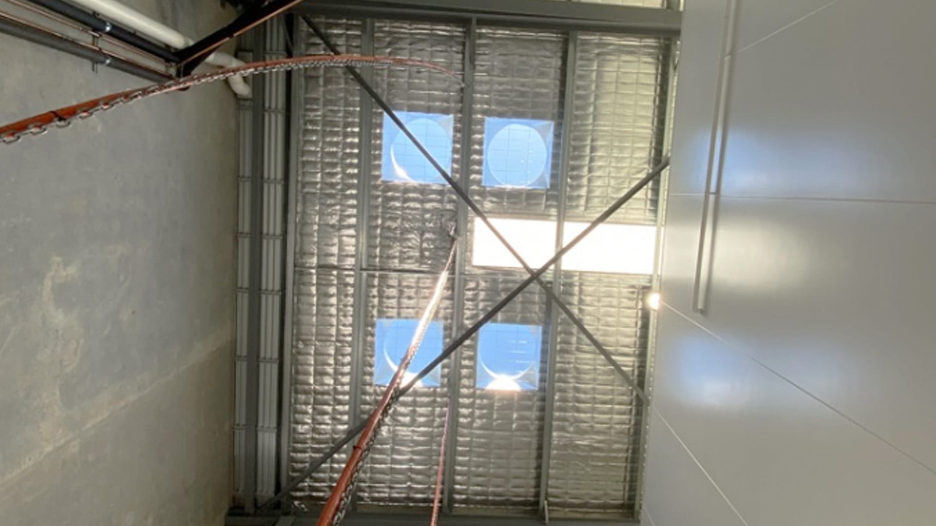 Installing 4 Wind Driven Roof Vents to Cool Refrigeration Units